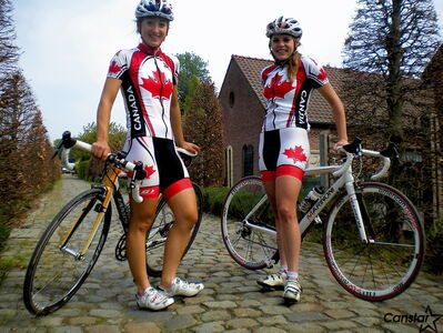 Winnipeg cyclists Leah Kirchmann (left) and Karlee Gendron have been proudly wearing the Maple Leaf throughout Western Europe as members of the Canadian national team.