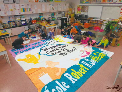 Grade 6 students at R.H. Smith School prepare a banner for their annual charity breakfast on March 1, which will benefit the Children's Wish Foundation.