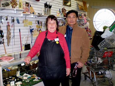 Carol Little, manager of the Goodwill Industries store at 1540 Pembina Hwy, with Art, one of her employees.