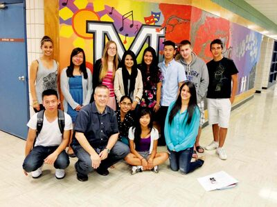 Maples Collegiate teacher Dariusz Piatek with the group of students he has served as teacher adviser since they were in Grade 9.