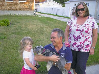 The author's daughter, Hope, meets Brandi and her owners Peter and Val while out on a people-watching stroll in Windsor Park.