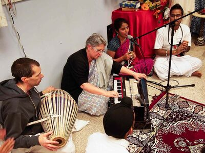 Four of 11 devotees from the Wolseley-based ISKCON temple participating at Krishna celebrations in Thunder Bay, August 17. From left to right: Nitai Rama dasa playing mrdanga, Vrnda devi dasi on harmonium, MahaSundari Radhika devi dasi leading the chanting and playing kartals, and Rahul Thakur.