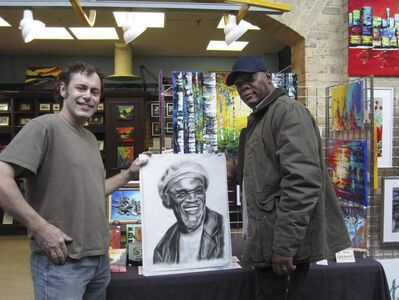 Samuel L. Jackson, in town for filming of Reasonable Doubt, dropped into the Lesia Anna Art Studio at The Forks yesterday and accepted a charcoal portrait done by artist Perry Holmes.