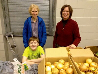 Charleswood food bank volunteers Darlene Lewis (blue jacket), Ethan Halwachs and Valerie Robertson.