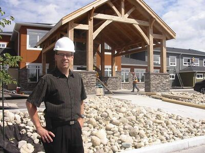 Gordon Daman, voluntary president of the new Heritage Life Personal Care Home in Niverville, oversees last-minute construction before its opening later this month.