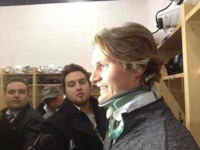 Jacob Trouba wears a neck brace Saturday after crashing into the boards head first Friday.
