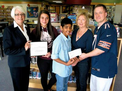 From left to right: Patricia Burgoyne, an assistant superintendent at Louis Riel School Division; student Nikki Yakubowski; student Robin Mann, Lois Edwards, co-chair of the Manitoba Chapter of Canadian Women for Women in Afghanistan; and teacher Rob Hrabluk at a recent cheque presentation at Island Lakes Community School. Staff and students organized a gala event earlier this year and raised more than $1,000 for the organization.