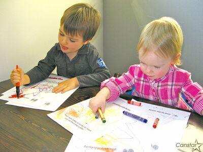 Pamela Delisle's children, Oscar (left) and Milla, are busy decorating greetings cards.