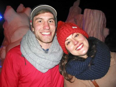 In this 2013 file photo, Festival du Voyageur revellers Cameron Hunter (left) and Rebecca Henderson are pictured having fun in front of a snow sculpture at Voyageur Park before heading off to watch the band Royal Canoe.