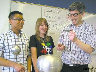 From left to right: Thomas Mah and Haley Boswick take a science lesson from Marshall Carroll at Vincent Massey Collegiate.