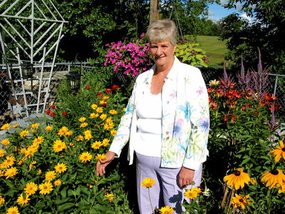 Val Johnson, a longtime member of the St. Vital Agricultural Society, in her backyard.