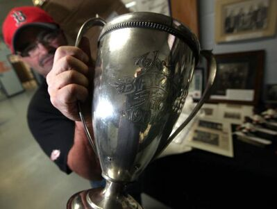 Ian Scott, president of the Carberry Curling Club, with the 112-year-old Bryan Trophy.