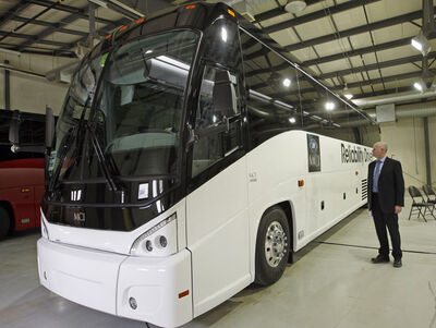 Bryan Couch, vice president and general manager of operations, announces the sale of buses to the Canadian Armed Forces at Motor Coach Industries plant on Clarence Avenue.