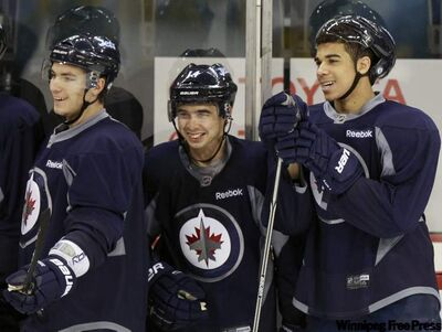 Winnipeg Jets (from left) Alexander Burmistrov, Tim Stapleton and Evander Kane during  practice in the MTS Centre Friday. The Winnipeg Jets play the Toronto Maple Leafs at 6 p.m. on Dec. 31 in the MTS Centre.