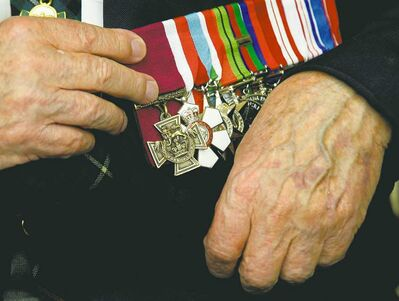 Ryan Remiorz / The Canadian Pres archivesPte. Ernest (Smokey) Smith displays his Victoria Cross. The last of Canada�s 94 Victoria Crosses were handed out during the Second World War, at a time when the British still oversaw the award on behalf of Commonwealth nations.