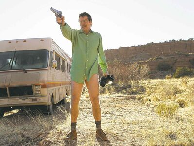 "This image released by AMC shows Walter White, played by Bryan Cranston, next to the Winnebago he uses as a mobile meth lab in the pilot episode of ""Breaking Bad."" The series finale of the popular drama series airs on Sunday, Sept. 29.  (AP Photo/AMC, Doug Hyun)"