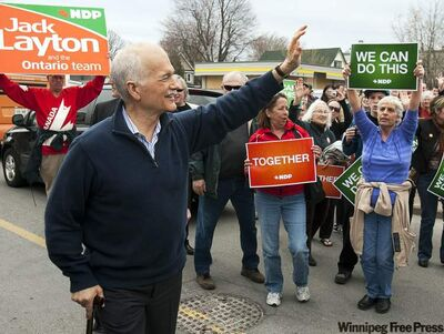 NDP Leader Jack Layton  waves to supporters as he makes a campaign stop in Kingston, Ont., on  Sunday. The federal election will be held Tuesday.