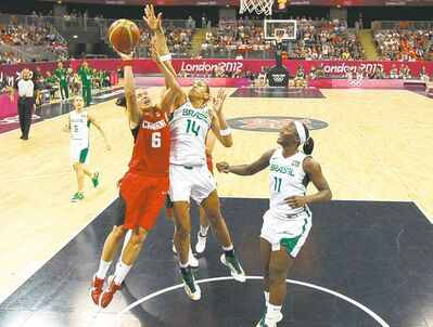 Mike Segar / the associated pressCanada�s Shona Thorburn drives to the hoop against Brazil�s Erika Souza (14) and Clarissa Santos during Friday�s Canadian victory.