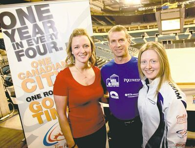 WAYNE GLOWACKI / WINNIPEG FREE PRESSChelsea Carey, Jeff Stoughton and Cathy Overton-Clapham second Ashley Howard (from left) publicize the Olympic curling Trials next Dec. 1-8 at the MTS Centre.
