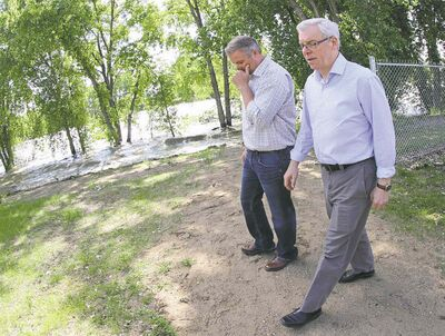 Premier Greg Selinger and RM of Portage la Prairie Reeve Kam Blight tour the control structure.