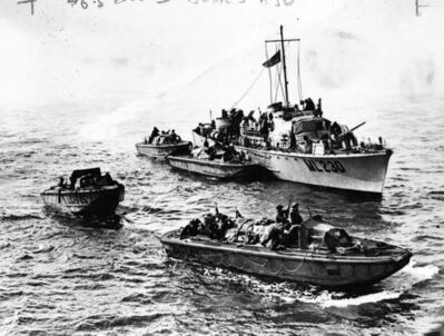 Landing craft draw away from motor torpedo boats as Canadian troops head for the beaches of Dieppe.