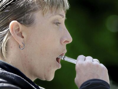 Rich Pedroncelli / The Associated Press files</p><p>California Highway Patrol Sgt. Jaimi Kenyon swabs for saliva while demonstrating a drug testing device. Bill C-46 will allow law enforcement to utilize such devices to test for levels of THC in persons suspected of drug impairment.</p></p></p>