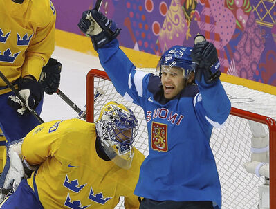 Olli Jokinen scored for Finland against Sweden goaltender Henrik Lundqvist today during the second period of the men's semifinal ice hockey game at the 2014 Winter Olympics. He'll play for a bronze medal on Sunday before returning to the Jets by next Tuesday or Wednesday