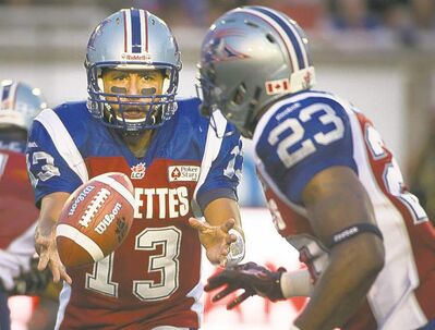 peter mccabe / the canadian press archivesAlouettes quarterback Anthony Calvillo shovels a pass to Jerome Messam during an Aug. 8 game against Toronto. Montreal was demolished 38-13.