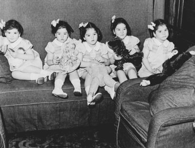 FILE--The Dionne quintuplets arev shown  in their train car, on trip to Toronto in this 1939 photo. (CP PHOTO/National Archives of Canada)