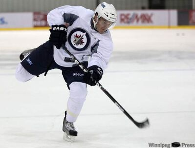 Winnipeg Jet Ben Maxwell lets a slapshot go at practice at MTS Iceplex Wednesday morning.