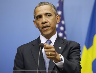 President Barack Obama gestures during his joint news conference with Swedish Prime Minister Fredrik Reinfeldt, Wednesday, Sept. 4, 2013, at the Rosenbad Building in Stockholm, Sweden. The president said international community and Congress credibility on the line on response to Syria . (AP Photo/Pablo Martinez Monsivais)