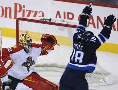 Winnipeg Jets Bryan Little celebrates after scoring the game winning goal against Florida Panthers goaltender Scott Clemmensen during overtime at MTS Centre in Winnipeg Tuesday.