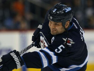 Mark Stuart went from the contending Bruins to the not-so-contending Thrashers.