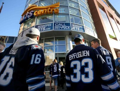 Winnipeg Jets fans walk into the MTS Centre.