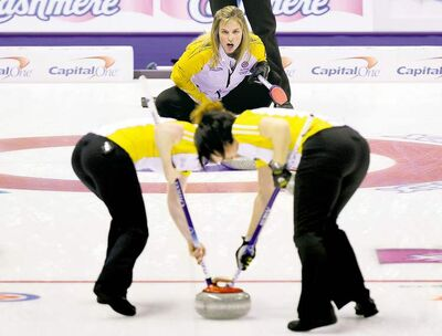 Todd Korol / reutersManitoba skip Jennifer Jones shouts instructions to lead Dawn Askin (left) and second Jill Officer during a win over Quebec on Thursday.