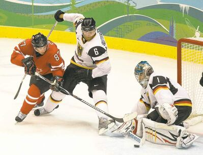Sven Butenschon spars with Sidney Crosby at the Vancouver Olympics.