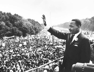 Martin Luther King, Jr. waves to throng from steps of Lincoln Memorial, Aug. 28, 1963