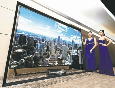 Samsung's 110-inch ultra-HD TV is presented Monday. Samsung is going the bigger-is-better route with its U-HDs.