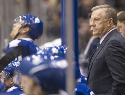 Leafs coach Ron Wilson looks on as fans chant 'Fire Wilson' during game against the Florida Panthers in Toronto Tuesday.