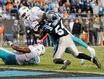 Miami Dolphins' Julius Thomas (89) runs past Carolina Panthers' Shaq Green-Thompson (54) for a tocudhown in the first half of an NFL football game in Charlotte, N.C., Monday, Nov. 13, 2017. (AP Photo/Mike McCarn)