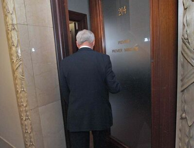 After a turbulent day with five senior ministers resigning from cabinet Premier Greg Selinger heads to his office after a ceremony where five new cabinet ministers were sworn in at the Manitoba Legislature Monday afternoon.