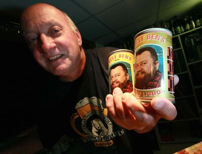 Nice cans! Rob Horwood, founder of the Great White North Brewerianists Club, shows off his collection of Canadian beer. (PHIL HOSSACK / WINNIPEG FREE PRESS)