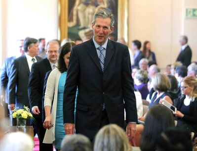 Manitoba Premier Brian Pallister leads the Progressive Conservative caucus to be sworn in.