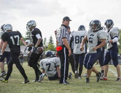Winnipeg Blue Bombers acting GM Kyle Walters serves as a linesman at a high school football game on Sept. 6 at Maples Collegiate.