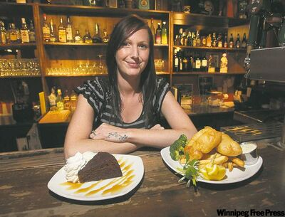 Sawney Beans owner Jackie Bakx serves some nicely done fish and chips and a slice of outstanding sticky toffee pudding.