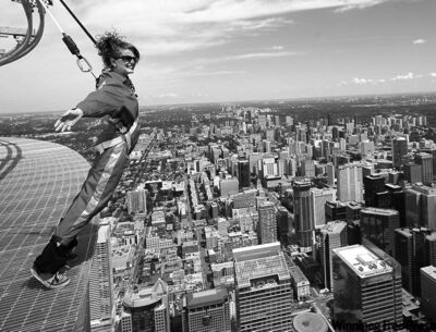 Darren Calabrese / the canadian pressReporter Alexandra Posadzki leans over the CN Tower to enjoy a sweeping view of Toronto�s downtown.