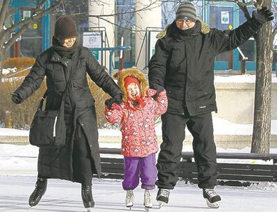 Judith Bowden and Jeff Cummings take their daughter Molly, 5, for a skate at The Forks.