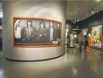 A large photo of the Rolling Stones dominates an exhibit space at the Rock and Roll Hall of Fame in Cleveland.