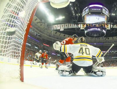 Andrew Shaw's game-winning goal flies into the net past goalie Tuuka Rask in triple overtime Wednesday night.