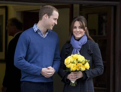 Britain's Prince William and his wife Kate, Duchess of Cambridge leave the King Edward VII hospital in central London, Thursday, Dec. 6, 2012.